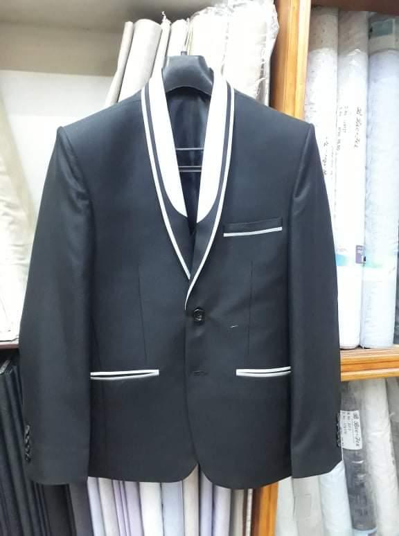 Rija Tailors Shirting Suiting and Tailoring Center